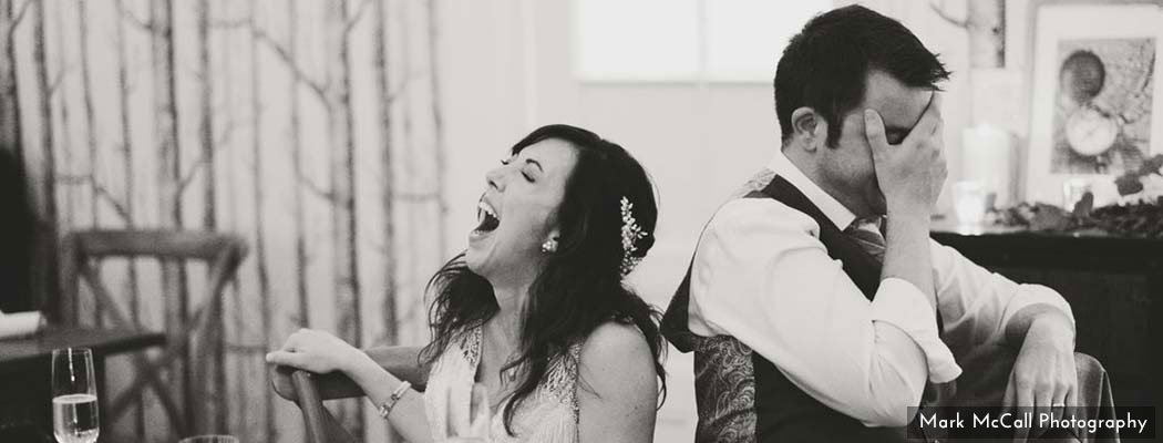 Laughing during wedding reception